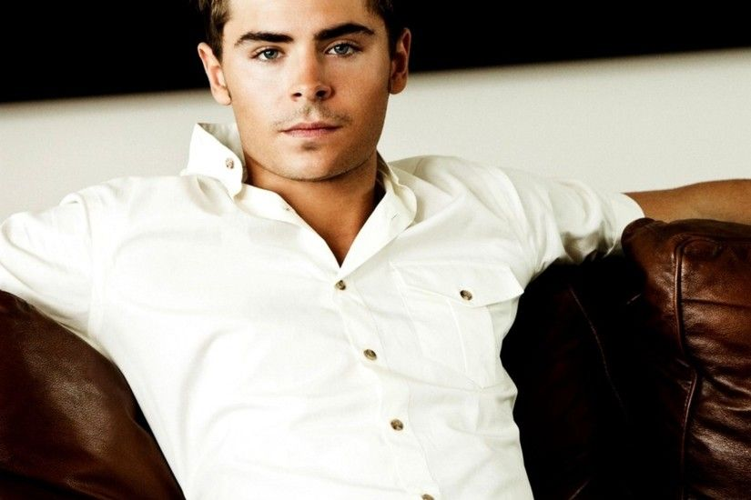 Preview wallpaper zac efron, celebrity, actor, shirt, sofa 2048x2048