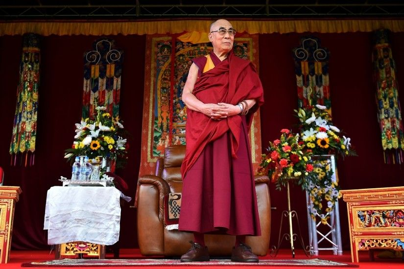 The Dalai Lama takes to the stage to address the faithful in Aldershot on  June 29