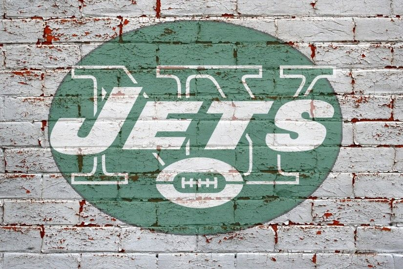 new york jets logo on grey brick wall