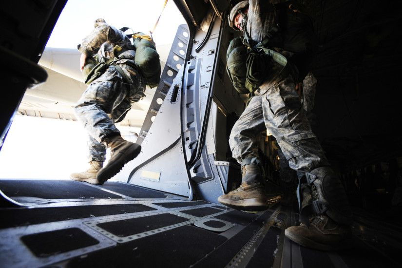 "American paratroopers from the U.S. Army's 82nd Airborne Division  participate in a ""friendship drop"""