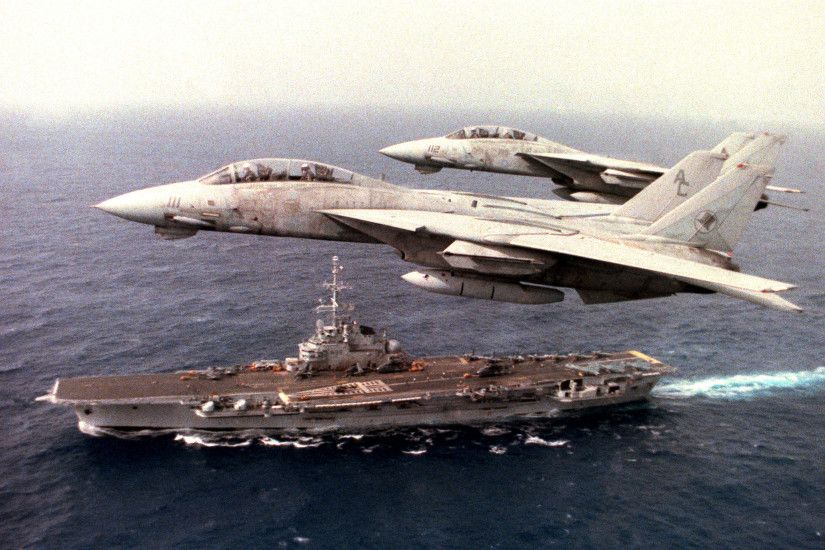 Fighter Squadron 14 (VF-14) F-14A Tomcat aircraft fly over the