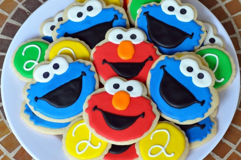 Download Elmo Cookie Monster wallpapers to your cell phone .