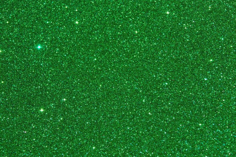 Sparkles Glitters on Green Background