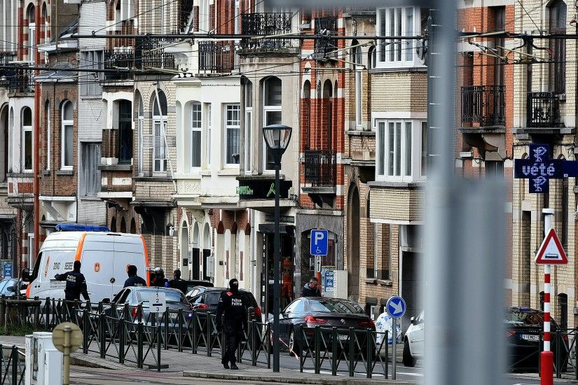 Police officers and bomb-squad members take part in an anti-terrorist  operation near