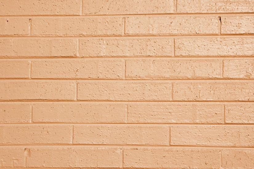 Light Orange or Peach Painted Brick Wall Texture