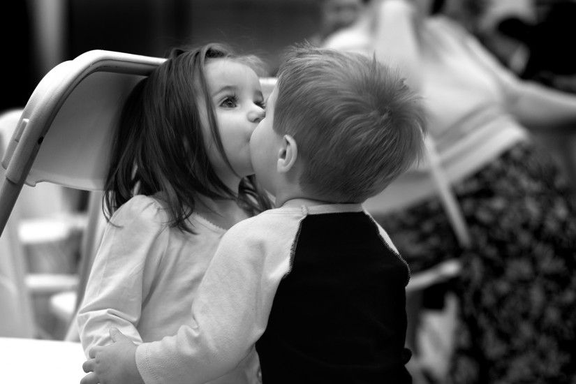 Cute small kids kissing