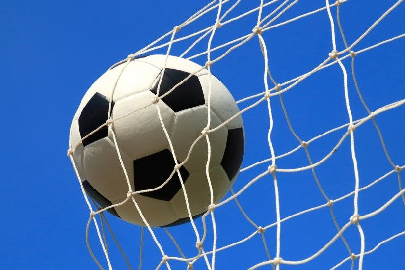 Soccer ball in the net wallpapers and images - wallpapers .