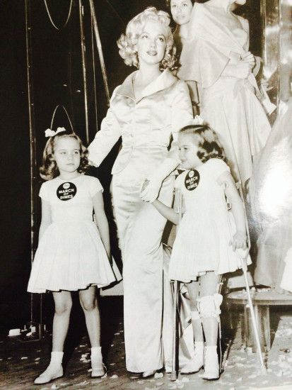 "Marilyn Monroe with ""March of Dimes"" poster children at the 1958 event held  at"