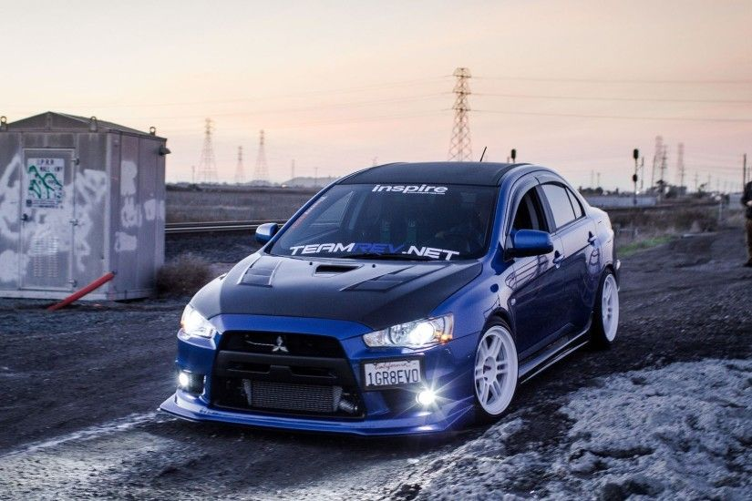 Mitsubishi EVO blue car lights drift 4k Wallpaper