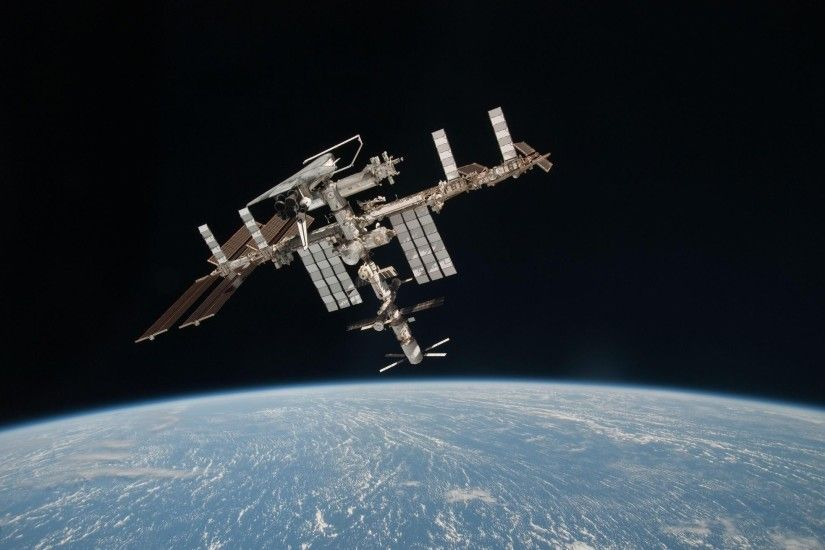 wallpaper The international space station in dark space. Next image →