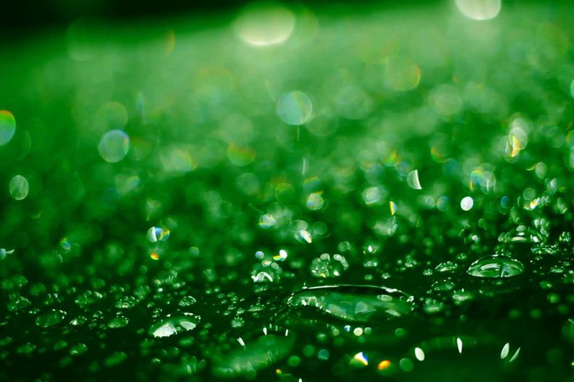 Droplets on glass after rain. Closeup of shiny water drops on glass after  rain. Green colored water droplets on glass. Water droplets. Abstract  background ...