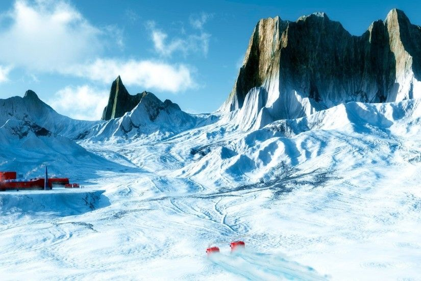 Sharp rocky peaks above the snowy mountains wallpaper
