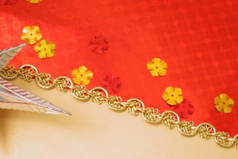 Preview wallpaper gold, red background, new year, toys 3840x1200