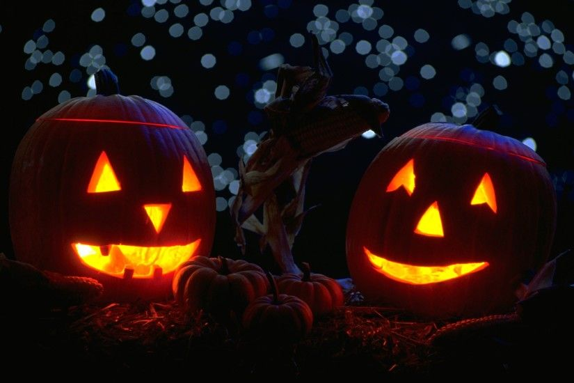 Pumpkins with candles in the night Halloween Widescreen Wallpapers.