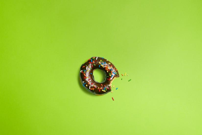 Chocolate donut on a green background