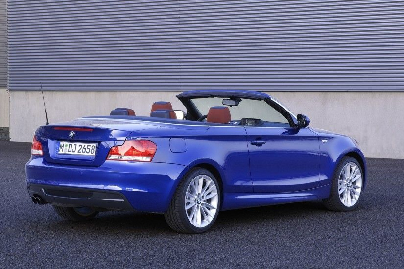 Parked by the wall blue convertible BMW 135i