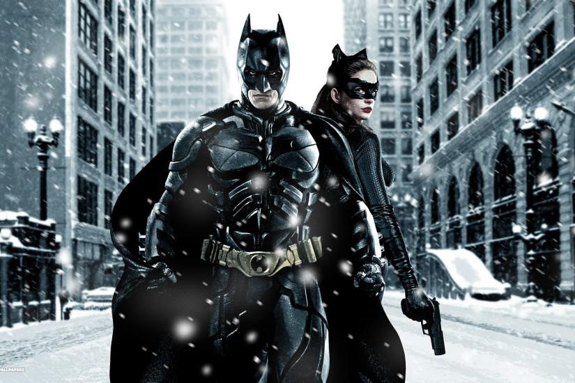 batman and catwoman in snow gotham city the dark knight rises