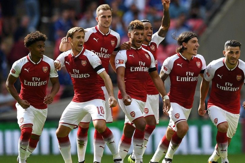 Arsenal players celebrate winning the penalty shootoutReuters