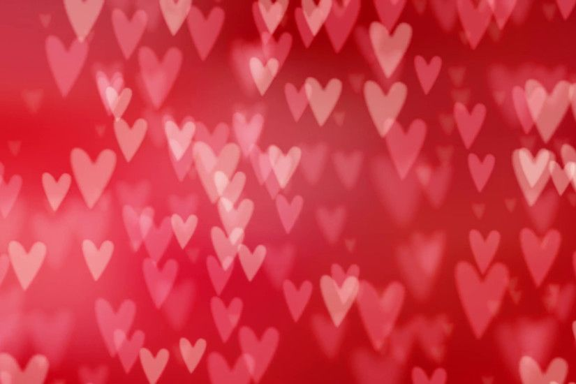 Valentines day or wedding abstract blurred background with falling red  hearts. Glittering bokeh lights. Love concept. Festive graphic HD animation.