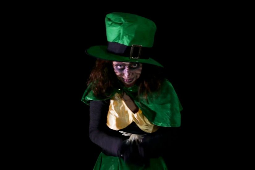 funny leprechuan in front of black background, hd video