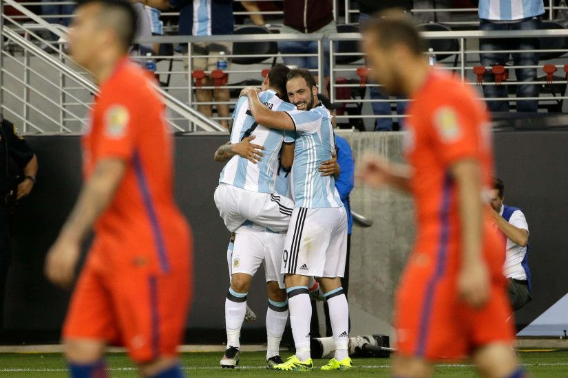 Argentina's Gonzalo Higuain, right, and Argentina's Angel Di Maria, left,  hug Argentina's