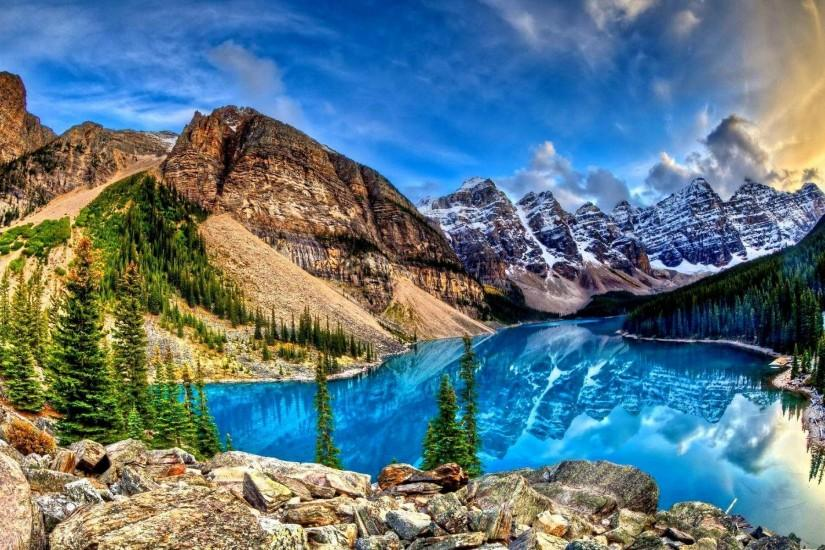 Amazing blue lake reflecting the mountains