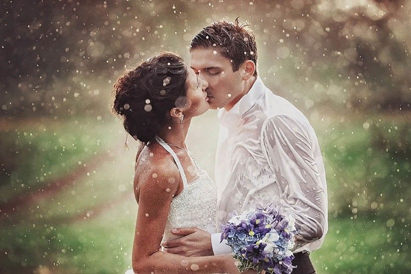 wedding kiss in rain