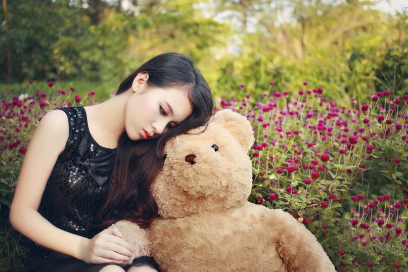 Cute asian girl with a teddy bear wallpaper