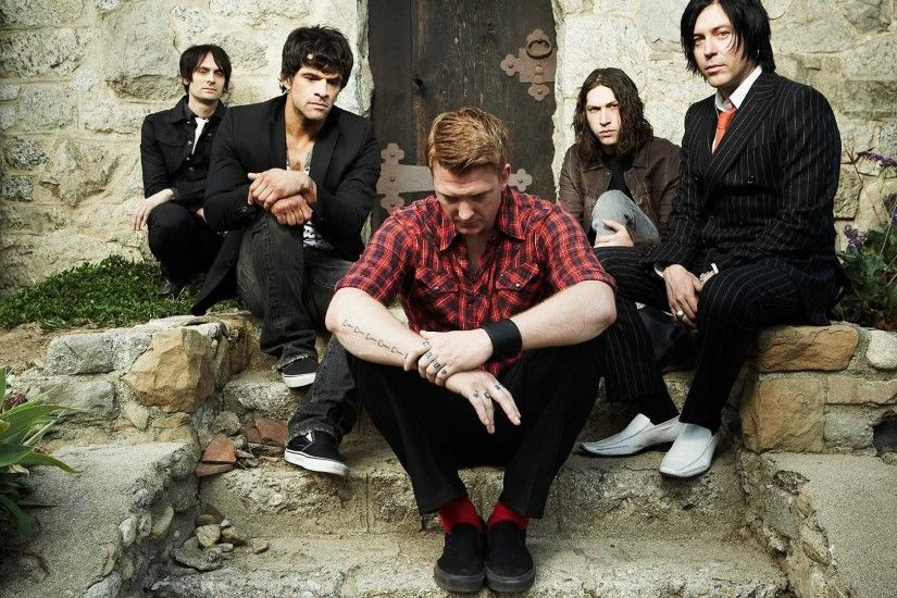 1920x1080 Wallpaper queens of the stone age, band, clothes, socks, red