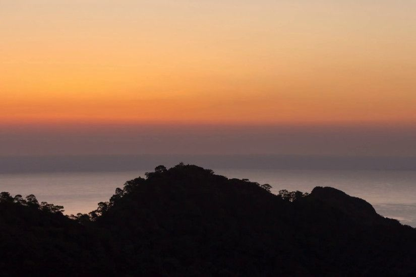 scenic sunrise background sun rising. timelapse of sun rising behing sea  and mountains Stock Video Footage - VideoBlocks