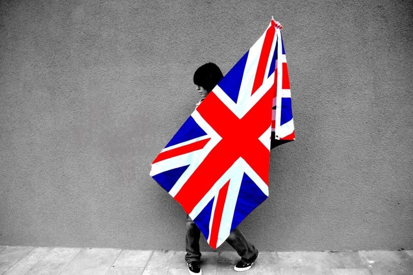 Girl Holding The Flag Of United Kingdom