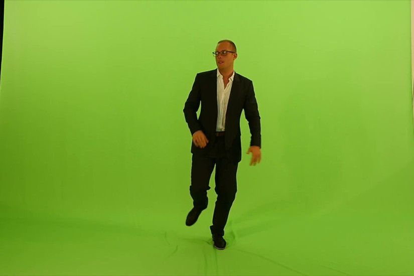 full body shot of man dancing isolated on green screen background