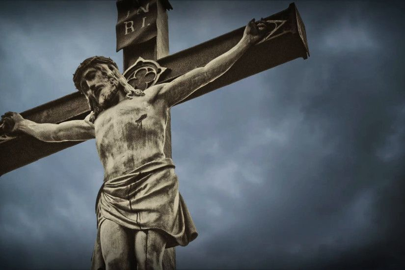 Crucifixion. Christian cross with Jesus Christ statue over stormy clouds  time lapse. Stock Video Footage - VideoBlocks