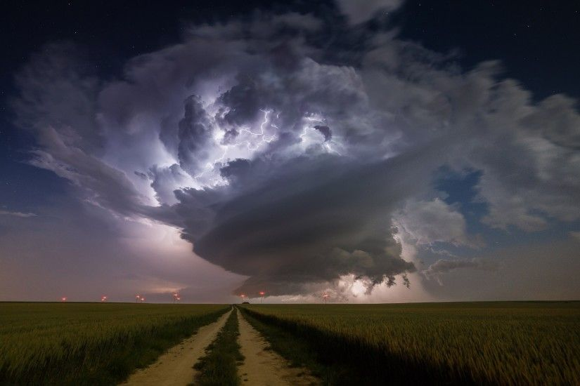 landscape lights nature sky field clouds lightning storm evening dirt road  horizon atmosphere windmill thunder supercell