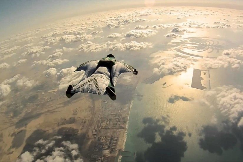 Once someone wearing a wingsuit jumps out of a plane they can control their  descent path and almost fly across the landscapes below.
