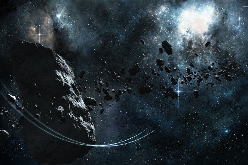 Large asteroid surrounded by smaller ones wallpaper