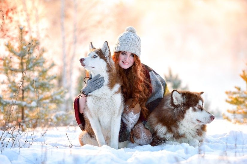 Girl In Snow With Siberian Husky