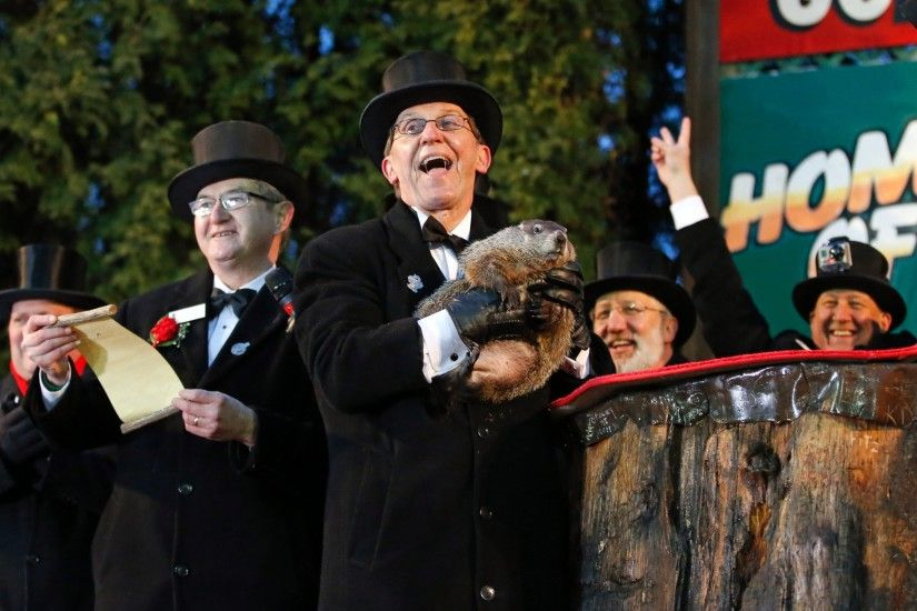 PHOTO: Groundhog Club handler Ron Ploucha, center, holds Punxsutawney Phil