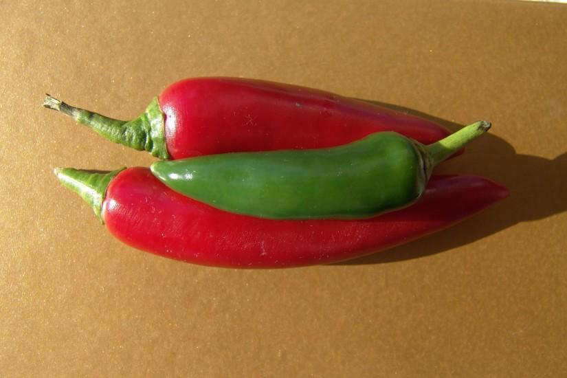 red-and-green-chilli-peppers-fresh-on-gold-