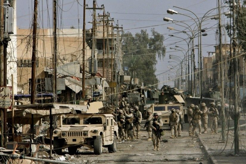 iraq street vehicles men grey war town