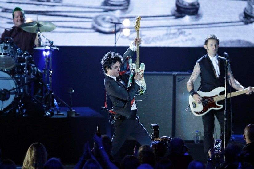 PHOTO: Billie Joe Armstrong , center, drummer Tre Cool and guitarist Mike  Dirnt ...