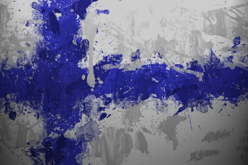 Finland flag with paint drops wallpaper