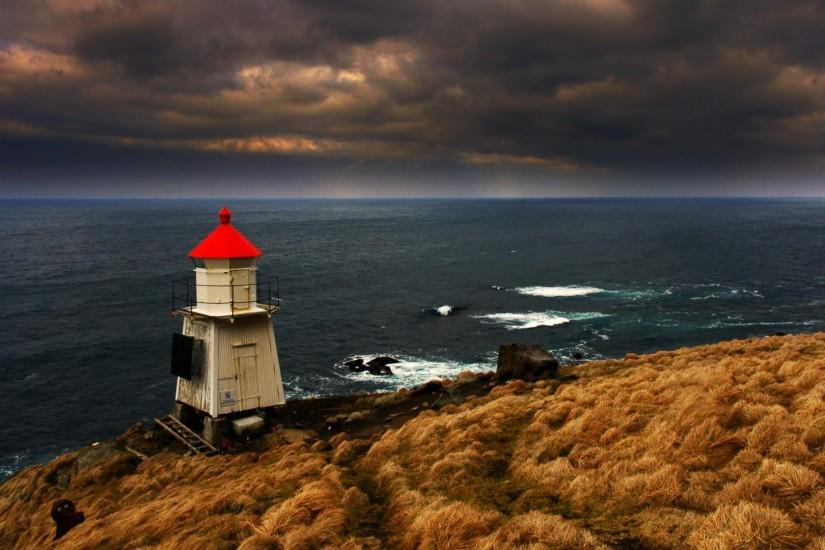 Wallpaper Lighthouse in stormy sea (1920 x 1080 HDTV 1080p). Desktop .