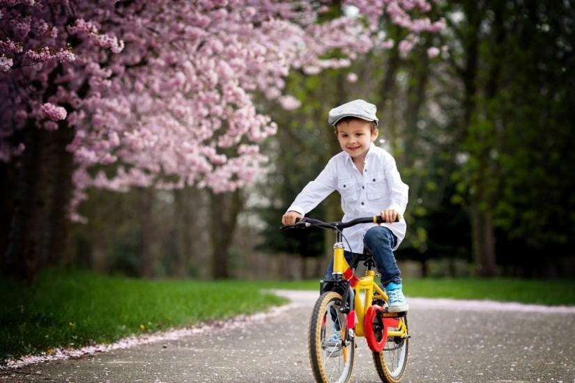 Cute baby on bicycle in the park superb wallpapers