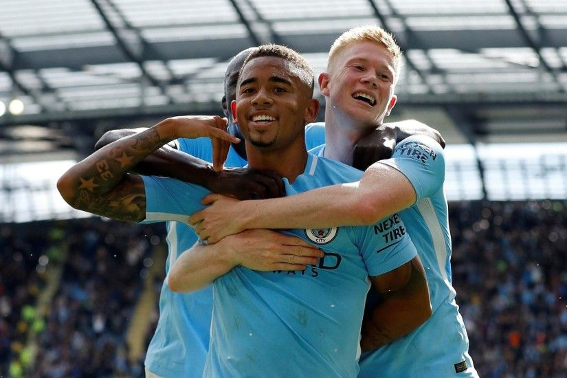 Manchester City's Gabriel Jesus celebrates scoring their second goal with  Benjamin Mendy and Kevin De BruyneReuters