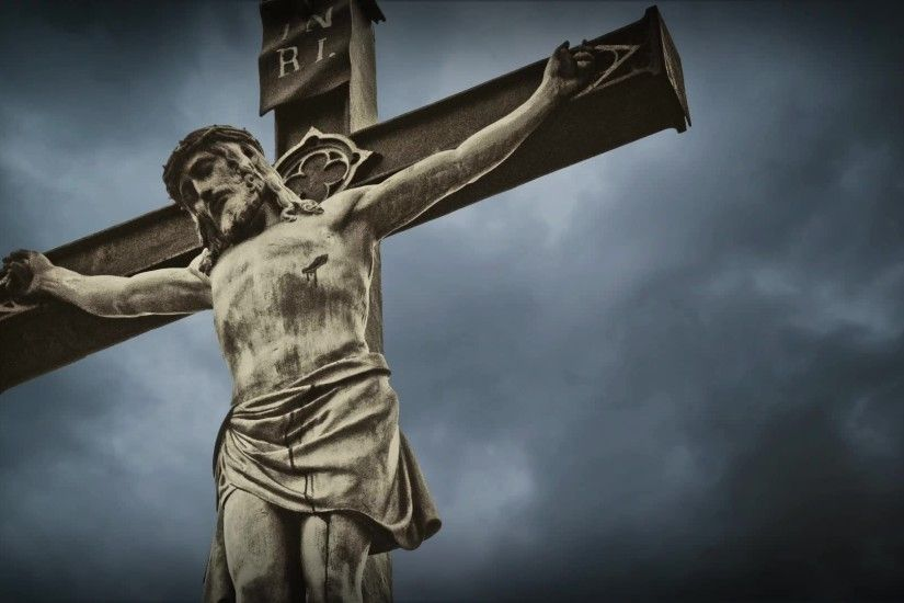 stock-footage-crucifixion-christian-cross-with-jesus-christ -statue-over-stormy-clouds-time-lapse-wallpaper-wp3809672