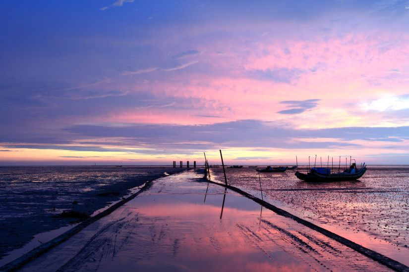Purple sunset above the fishing boats wallpaper
