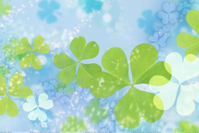 Green Leaves On Cool Blue Background Wallpaper