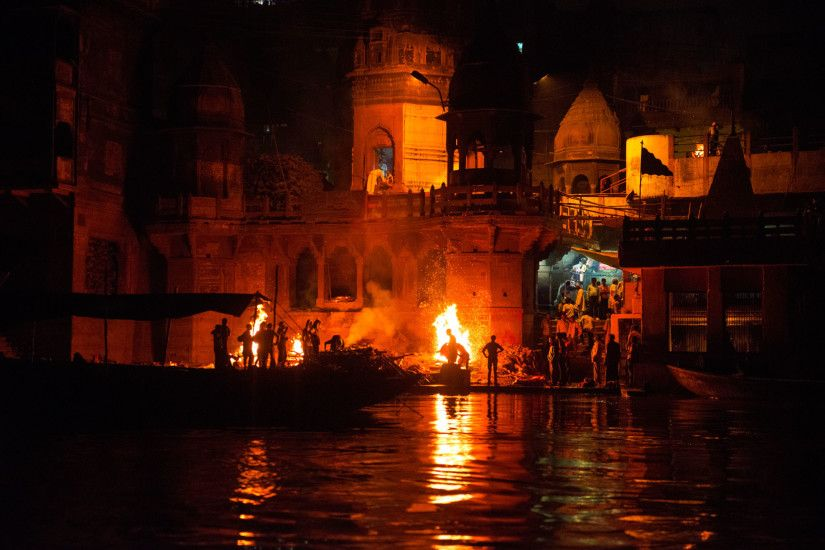 The burning ghat in Varanasi, India's oldest city, glows as burning pyres  continue through the night.