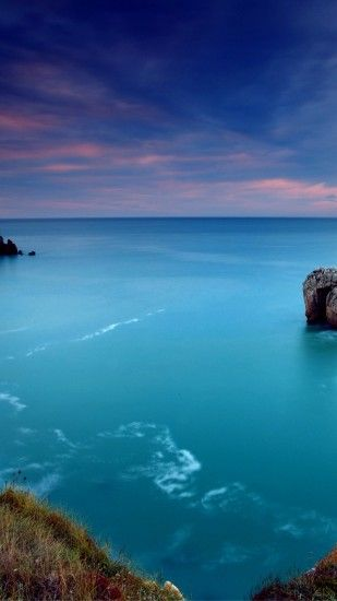 Preview wallpaper ocean, gulf, coast, blue water, lilac, evening 1440x2560